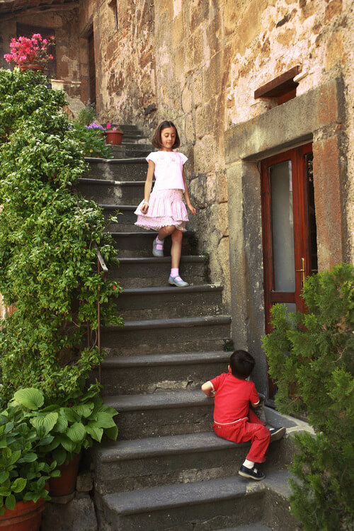 Girl on stairs Civita di Bagnoregio photograph by Christopher Kufner